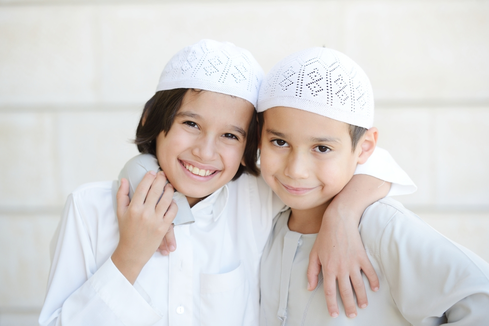 enfant souriant qamis
